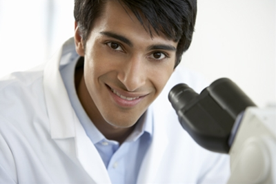 young-man-with-a-microscope-looking-at-camera