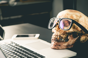 skull with glasses on a desk for halloween