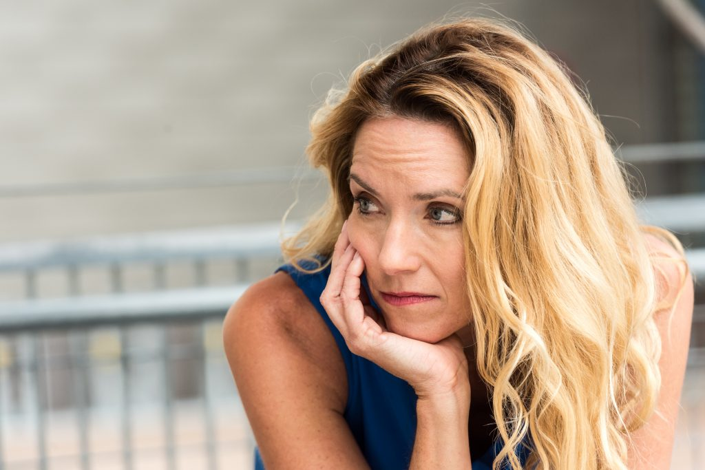 pensive blond woman