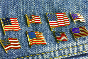 american flag pins on a jean jacket
