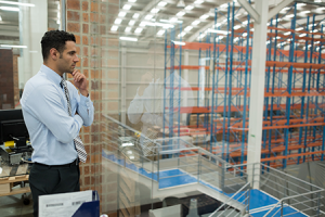 man overlooking manufacturing floor