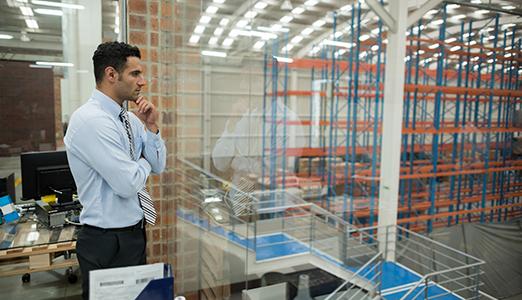 man overlooking manufacturing floor