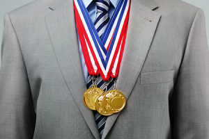 Suited worker wearing gold medals
